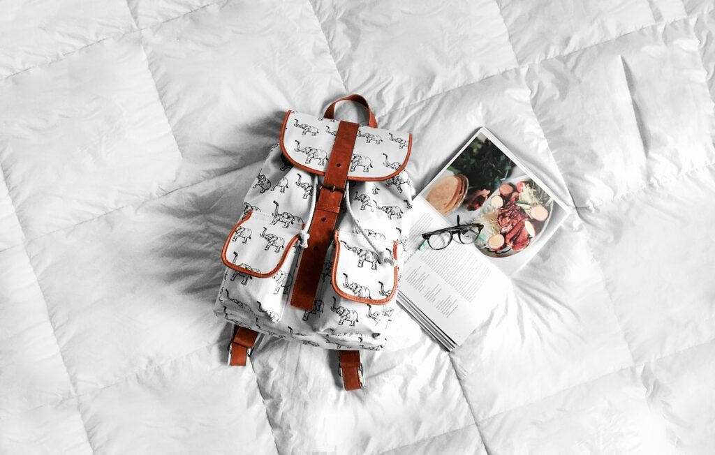 backpack, bed, book